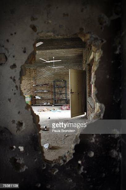 A classroom is seen through a hole in a bulletridden wall inside the destroyed Red mosque on July 12 2007 in Islamabad Pakistan Government reports...