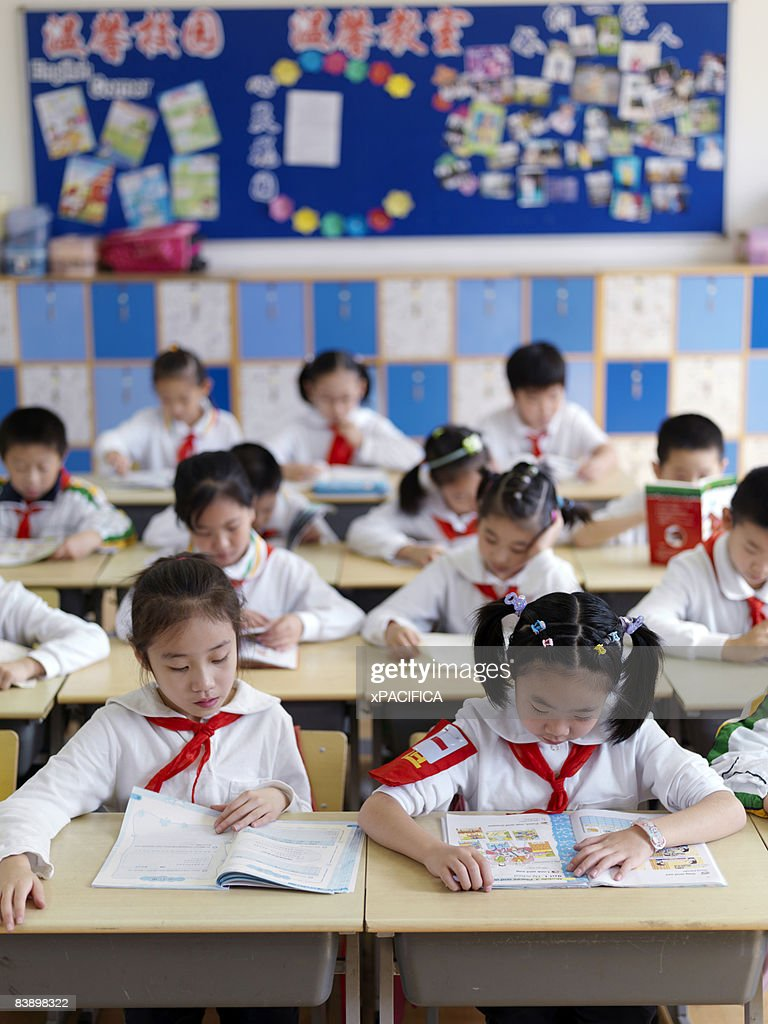 A classroom of students focusing on a lesson.  : Stock Photo