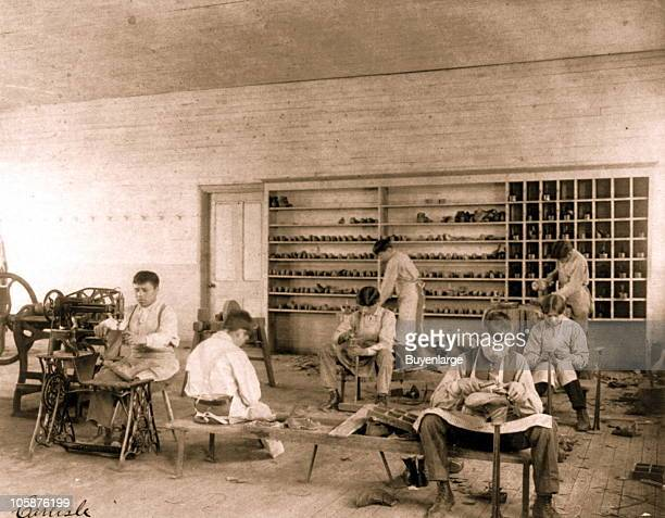 Classroom scenes at the Carlisle Indian School in Carlisle PA 1901 Male students learn the craft of shoe making and repair