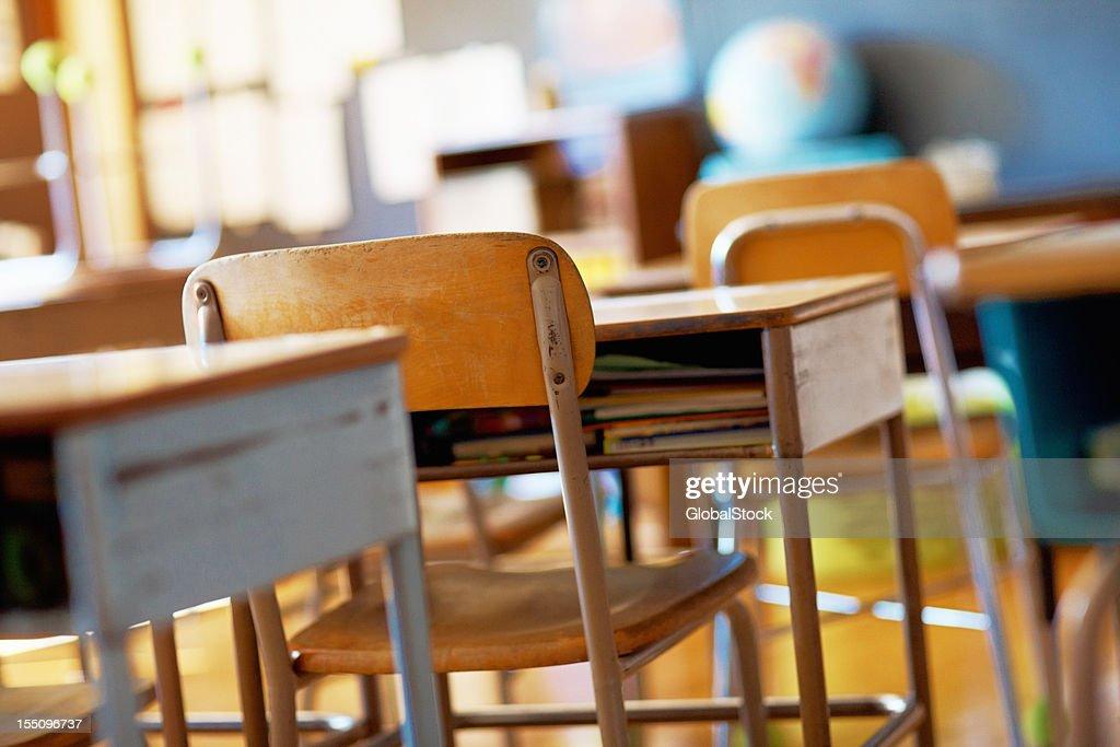 Classroom with empty wooden desks : Stock Photo