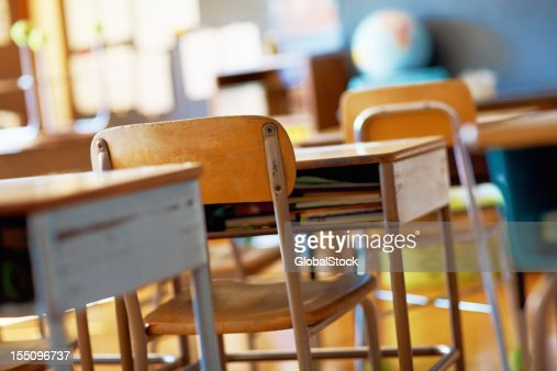 Classroom with empty wooden desks