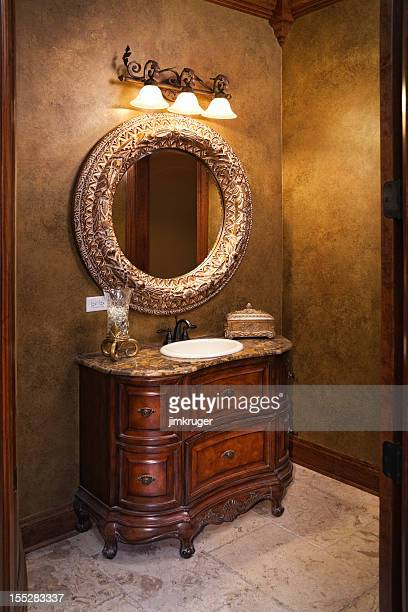 Classy elegant powder room in gold.