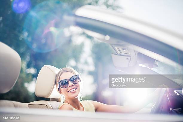 Classy woman driving a car