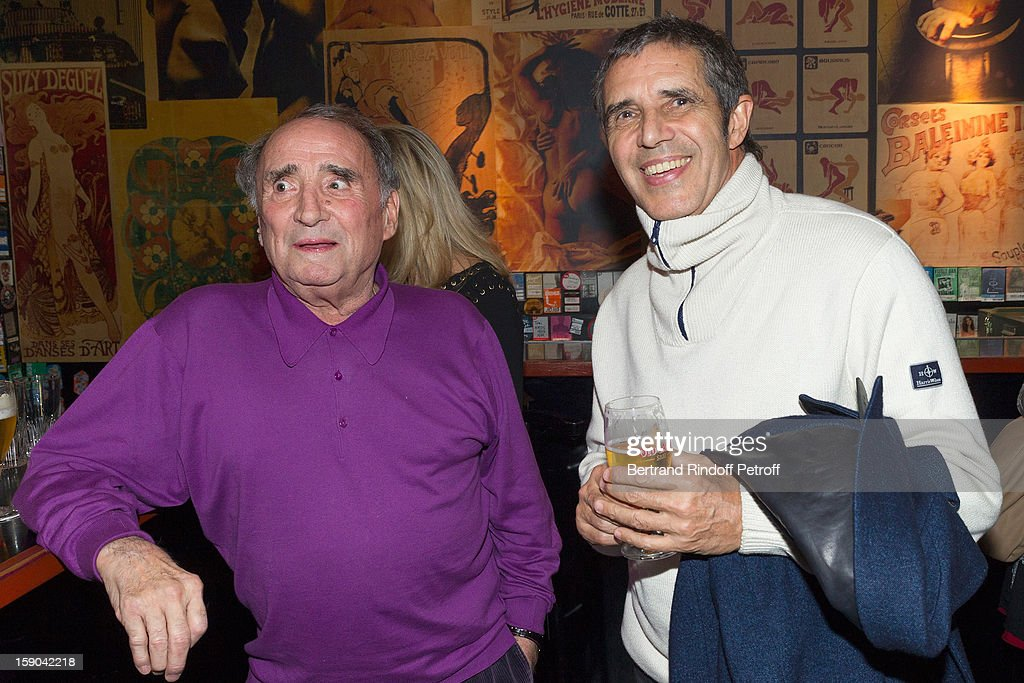 Claude Brasseur and Julien Clerc pose prior to attending the show of French impersonator Laurent Gerra at Olympia hall on January 5, 2013 in Paris, France.