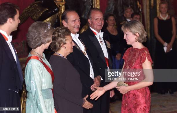 Claude Chirac daughter of French President Jacques Chirac shakes hands with her mother Bernadette as Spain's King Juan Carlos Spain's Queen Sophia...