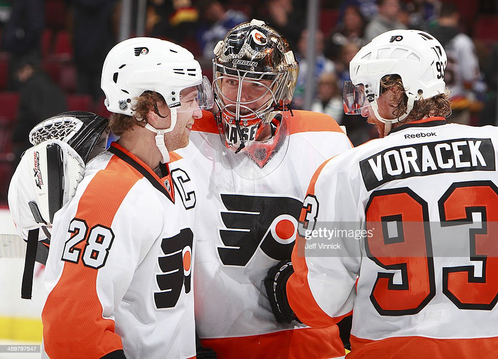 <a gi-track='captionPersonalityLinkClicked' href=/galleries/search?phrase=Claude+Giroux&family=editorial&specificpeople=537961 ng-click='$event.stopPropagation()'>Claude Giroux</a> #28 and <a gi-track='captionPersonalityLinkClicked' href=/galleries/search?phrase=Jakub+Voracek&family=editorial&specificpeople=4111797 ng-click='$event.stopPropagation()'>Jakub Voracek</a> #93 of the Philadelphia Flyers congratulate goalie Steve Mason #35 after a victory over the Vancouver Canucks in an NHL game at Rogers Arena December 30, 2013 in Vancouver, British Columbia, Canada. Philadelphia won 4-3.