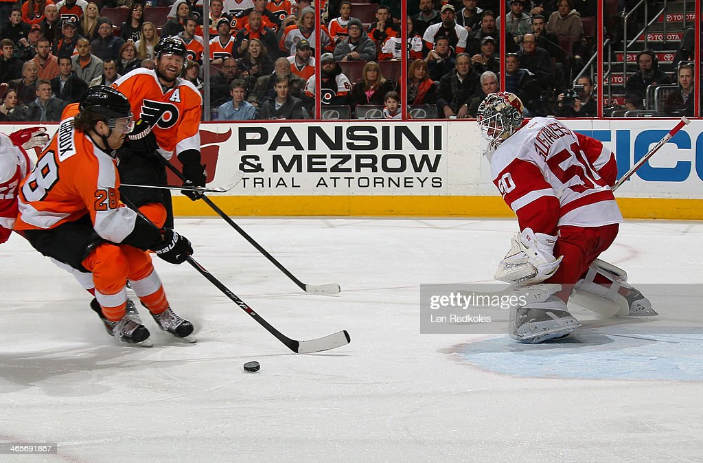 <a gi-track='captionPersonalityLinkClicked' href=/galleries/search?phrase=Claude+Giroux&family=editorial&specificpeople=537961 ng-click='$event.stopPropagation()'>Claude Giroux</a> #28 and <a gi-track='captionPersonalityLinkClicked' href=/galleries/search?phrase=Scott+Hartnell&family=editorial&specificpeople=201889 ng-click='$event.stopPropagation()'>Scott Hartnell</a> #19 of the Philadelphia Flyers attempt a scoring chance on <a gi-track='captionPersonalityLinkClicked' href=/galleries/search?phrase=Jonas+Gustavsson&family=editorial&specificpeople=886789 ng-click='$event.stopPropagation()'>Jonas Gustavsson</a> #50 of the Detroit Red Wings on January 28, 2014 at the Wells Fargo Center in Philadelphia, Pennsylvania. The Flyers went on to defeat the Red Wings 5-0.