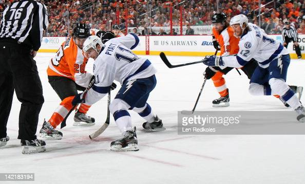 Claude Giroux and Scott Hartnell of the Philadelphia Flyers battle on a faceoff against Tom Pyatt and Ryan Malone of the Tampa Bay Lightning on March...