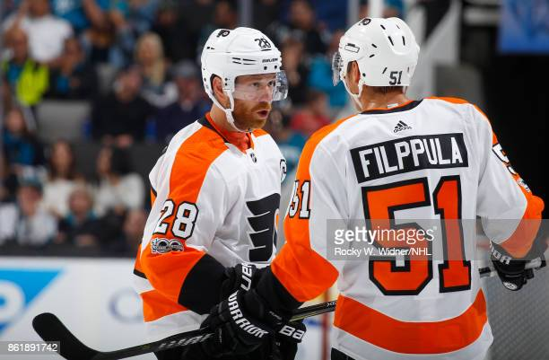 Claude Giroux and Valtteri Filppula of the Philadelphia Flyers have a talk during a NHL game against the San Jose Sharks at SAP Center at San Jose on...