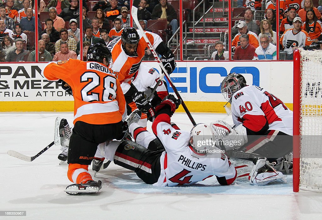 <a gi-track='captionPersonalityLinkClicked' href=/galleries/search?phrase=Claude+Giroux&family=editorial&specificpeople=537961 ng-click='$event.stopPropagation()'>Claude Giroux</a> #28 and <a gi-track='captionPersonalityLinkClicked' href=/galleries/search?phrase=Wayne+Simmonds&family=editorial&specificpeople=4212617 ng-click='$event.stopPropagation()'>Wayne Simmonds</a> #17 of the Philadelphia Flyers battle with Chris Phillips #4 of the Ottawa Senators in front of goaltender <a gi-track='captionPersonalityLinkClicked' href=/galleries/search?phrase=Robin+Lehner&family=editorial&specificpeople=5894610 ng-click='$event.stopPropagation()'>Robin Lehner</a> #40 on April 11, 2013 at the Wells Fargo Center in Philadelphia, Pennsylvania. The Senators went on to defeat the Flyers 3-1.