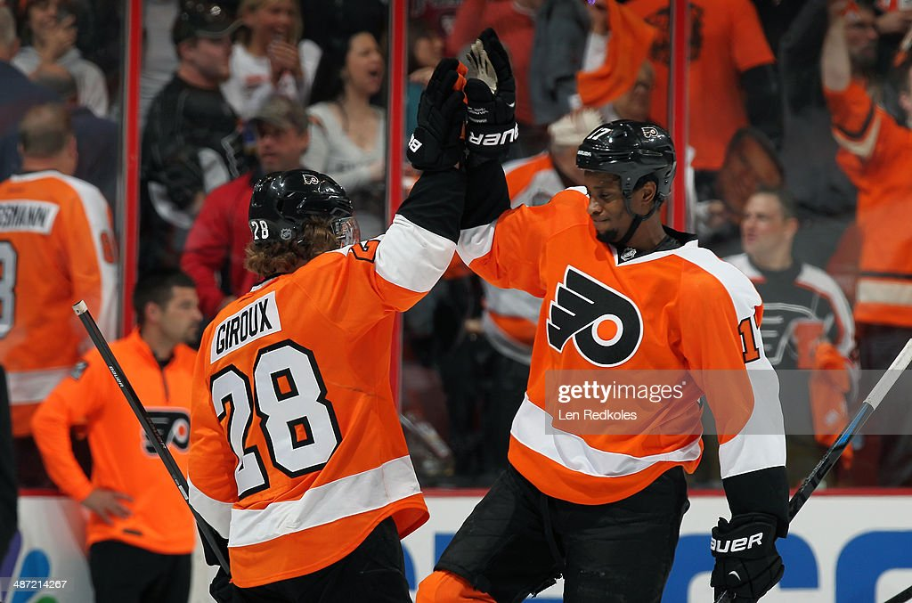Claude Giroux and Wayne Simmonds of the Philadelphia Flyers celebrate a 21 win over the New York Rangers in Game Four of the First Round of the 2014...