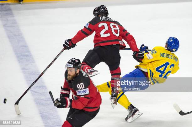 Claude Giroux clashes with Joakim Nordstrom during the Ice Hockey World Championship Gold medal game between Canada and Sweden at Lanxess Arena in...