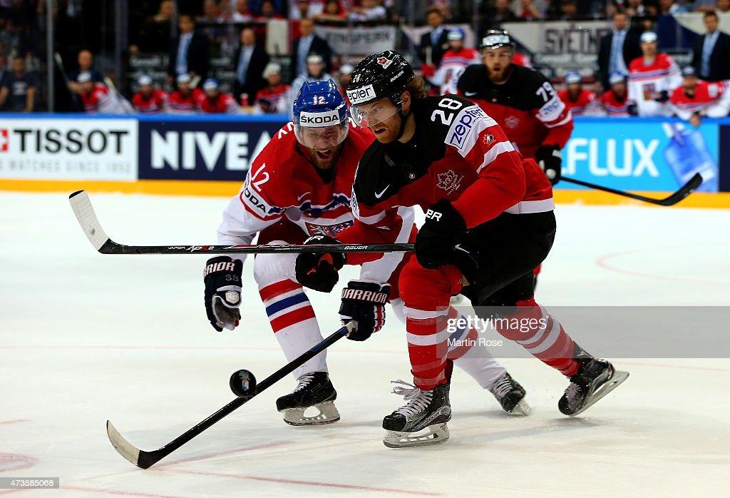 Claude Giroux (R) of Canada and Jiri Novotny (L) of Czech Republic battle for the puck during the IIHF World Championship semi final match between Canada and Czech Republic at O2 Arena on May 16, 2015 in Prague, Czech Republic.