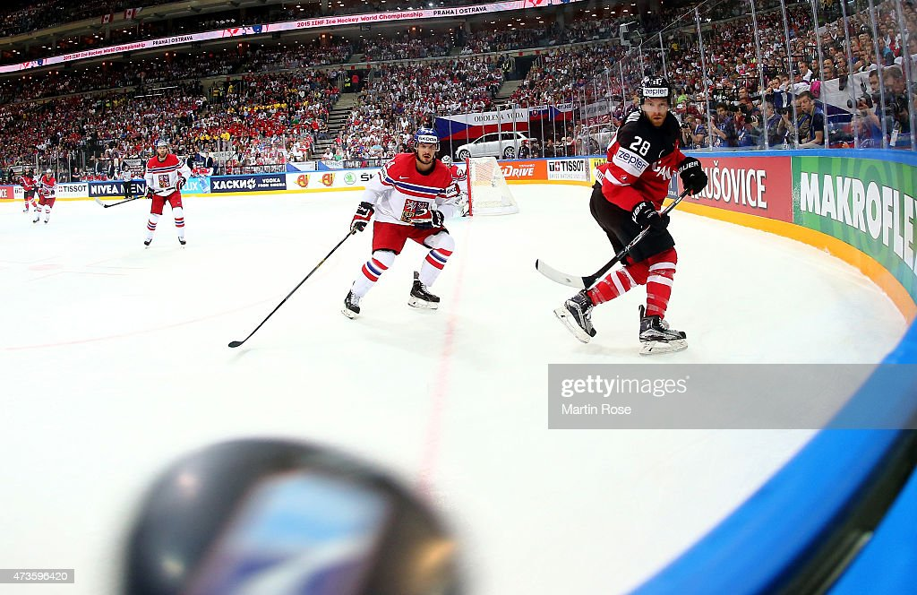 Claude Giroux (R) of Canada and Tomas Plekanec (R) of Czech Republic battle for the puck during the IIHF World Championship semi final match between Canada and Czech Republic at O2 Arena on May 16, 2015 in Prague, Czech Republic.