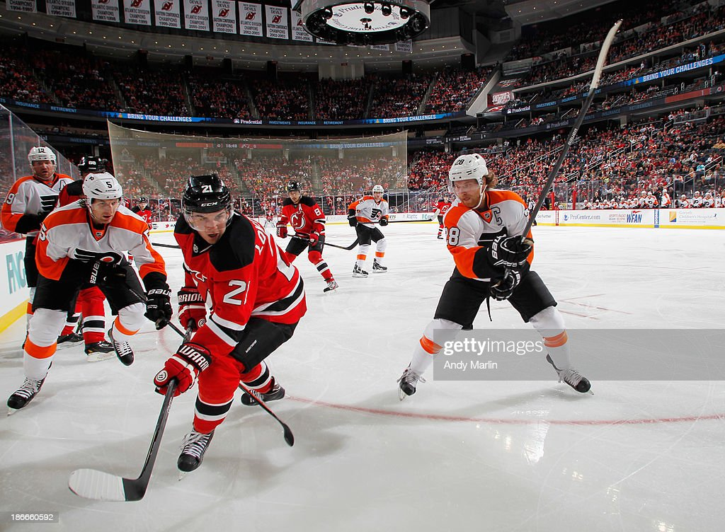 <a gi-track='captionPersonalityLinkClicked' href=/galleries/search?phrase=Claude+Giroux&family=editorial&specificpeople=537961 ng-click='$event.stopPropagation()'>Claude Giroux</a> #28 of the Philadelphia Flyers and <a gi-track='captionPersonalityLinkClicked' href=/galleries/search?phrase=Andrei+Loktionov&family=editorial&specificpeople=5370946 ng-click='$event.stopPropagation()'>Andrei Loktionov</a> #21 of the New Jersey Devils skate during the game at the Prudential Center on November 2, 2013 in Newark, New Jersey.