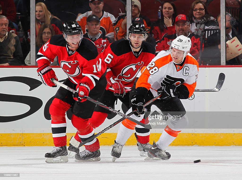 <a gi-track='captionPersonalityLinkClicked' href=/galleries/search?phrase=Claude+Giroux&family=editorial&specificpeople=537961 ng-click='$event.stopPropagation()'>Claude Giroux</a> #28 of the Philadelphia Flyers and <a gi-track='captionPersonalityLinkClicked' href=/galleries/search?phrase=Jacob+Josefson&family=editorial&specificpeople=5648065 ng-click='$event.stopPropagation()'>Jacob Josefson</a> #16 of the New Jersey Devils battle for a loose puck during the Devils' home opener at the Prudential Center on January 22, 2013 in Newark, New Jersey. The Devils shutout the Flyers 3-0.
