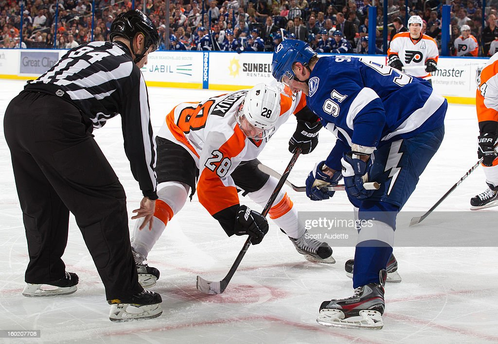<a gi-track='captionPersonalityLinkClicked' href=/galleries/search?phrase=Claude+Giroux&family=editorial&specificpeople=537961 ng-click='$event.stopPropagation()'>Claude Giroux</a> #28 of the Philadelphia Flyers and <a gi-track='captionPersonalityLinkClicked' href=/galleries/search?phrase=Steven+Stamkos&family=editorial&specificpeople=4047623 ng-click='$event.stopPropagation()'>Steven Stamkos</a> #91 of the Tampa Bay Lightning set up for a face off during the second period of an NHL game at the Tampa Bay Times Forum on January 27, 2013 in Tampa, Florida.