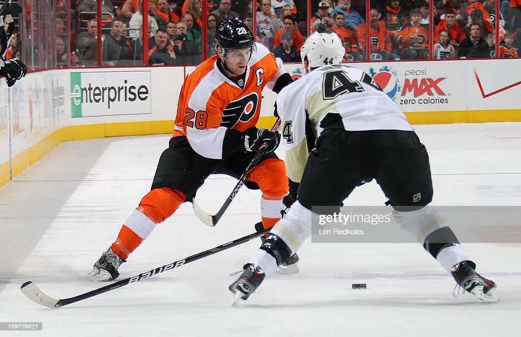 Claude Giroux #28 of the Philadelphia Flyers attempts to make a move around Brooks Orpik #44 of the Pittsburgh Penguins on January 19, 2013 at the Wells Fargo Center in Philadelphia, Pennsylvania.