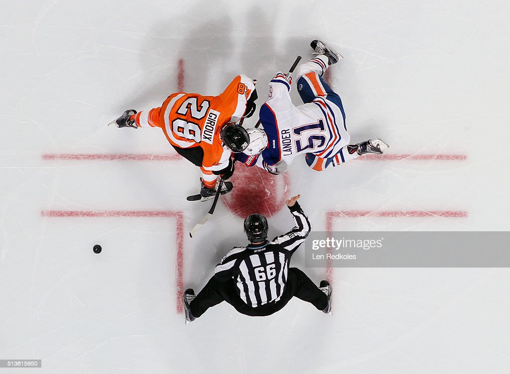 Claude Giroux #28 of the Philadelphia Flyers battles for the loose puck after a faceoff with Anton Lander #51 of the Edmonton Oilers on March 3, 2016 at the Wells Fargo Center in Philadelphia, Pennsylvania. The Oilers went on to defeat the Flyers 4-0.