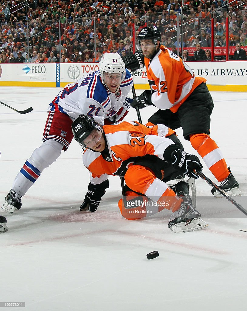 <a gi-track='captionPersonalityLinkClicked' href=/galleries/search?phrase=Claude+Giroux&family=editorial&specificpeople=537961 ng-click='$event.stopPropagation()'>Claude Giroux</a> #28 of the Philadelphia Flyers battles with <a gi-track='captionPersonalityLinkClicked' href=/galleries/search?phrase=Derek+Stepan&family=editorial&specificpeople=4687181 ng-click='$event.stopPropagation()'>Derek Stepan</a> #21 of the New York Rangers after a face-off on April 16, 2013 at the Wells Fargo Center in Philadelphia, Pennsylvania.
