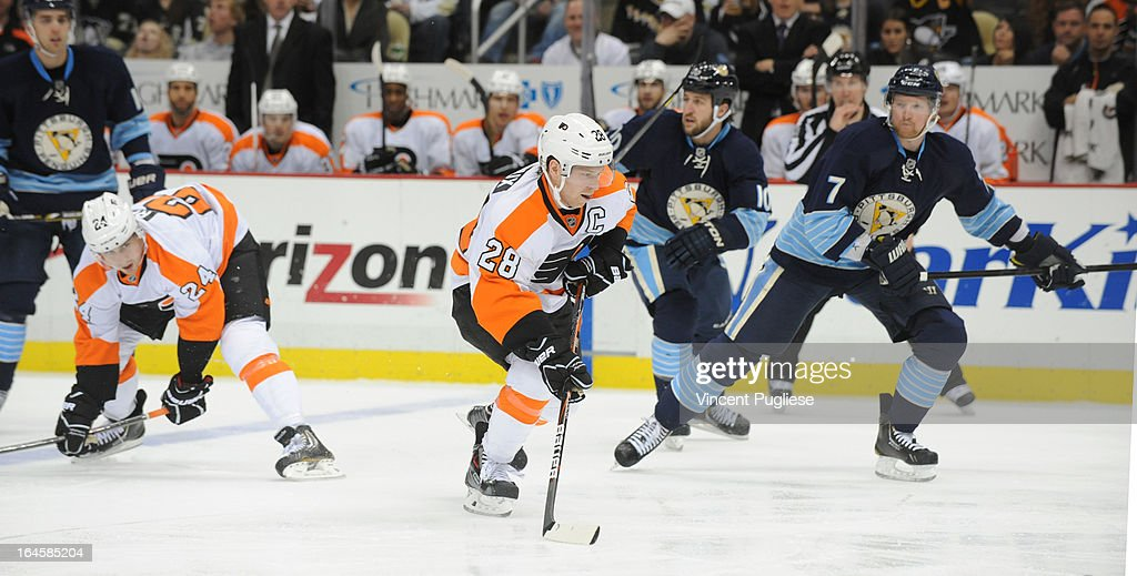 <a gi-track='captionPersonalityLinkClicked' href=/galleries/search?phrase=Claude+Giroux&family=editorial&specificpeople=537961 ng-click='$event.stopPropagation()'>Claude Giroux</a> #28 of the Philadelphia Flyers carries into the Pittsburgh Penguins zone during the second period onMarch 24, 2013 at the CONSOL Energy Center in Pittsburgh, Pennsylvania.