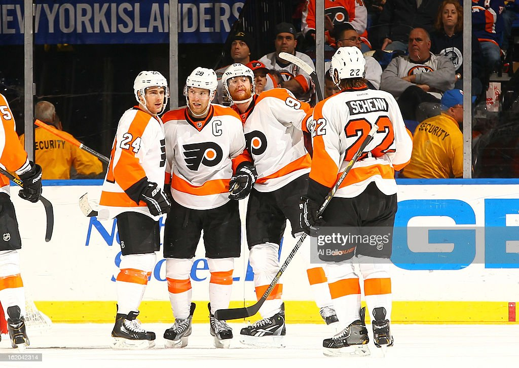 Claude Giroux #28 of the Philadelphia Flyers celebrates a gola with his teamates against the New York Islanders during their game at Nassau Veterans Memorial Coliseum on February 18, 2013 in Uniondale, New York.