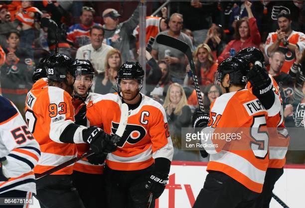 Claude Giroux of the Philadelphia Flyers celebrates his first period powerplay goal against the Edmonton Oilers with teammates Jakub Voracek Shayne...
