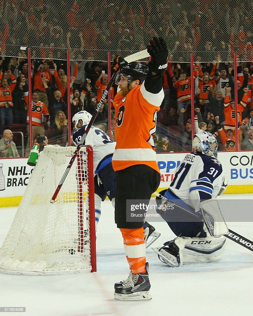 Claude Giroux #28 of the Philadelphia Flyers celebrates his game winning goal at 4:46 of overtime against Ondrej Pavelec #31 of the Winnipeg Jets at the Wells Fargo Center on March 28, 2016 in Philadelphia, Pennsylvania. The Flyers defeated the Jets 3-2 in overtime.