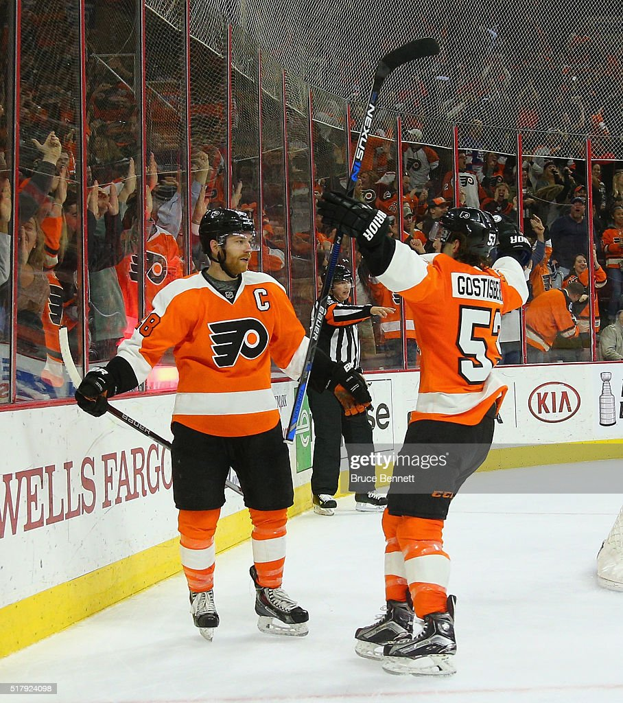 Claude Giroux #28 (l) of the Philadelphia Flyers celebrates his game winning goal at 4:46 of overtime against Ondrej Pavelec #31 of the Winnipeg Jets and is joined by Shayne Gostisbehere #53 (r) at the Wells Fargo Center on March 28, 2016 in Philadelphia, Pennsylvania. The Flyers defeated the Jets 3-2 in overtime.