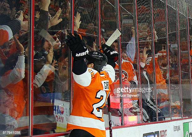 Claude Giroux of the Philadelphia Flyers celebrates his game winning goal at 446 of overtime against the Winnipeg Jets at the Wells Fargo Center on...