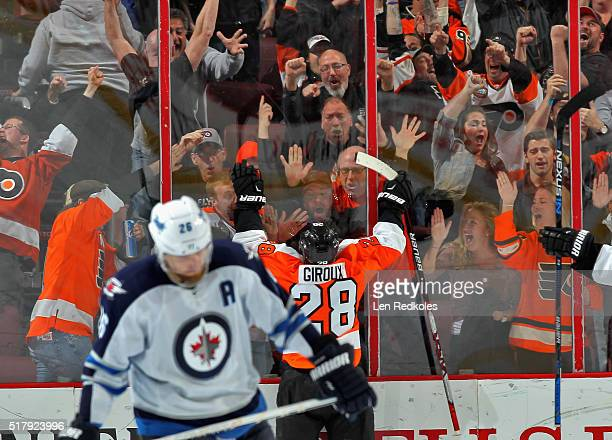 Claude Giroux of the Philadelphia Flyers celebrates his gamewinning overtime goal against the Winnipeg Jets on March 28 2016 at the Wells Fargo...