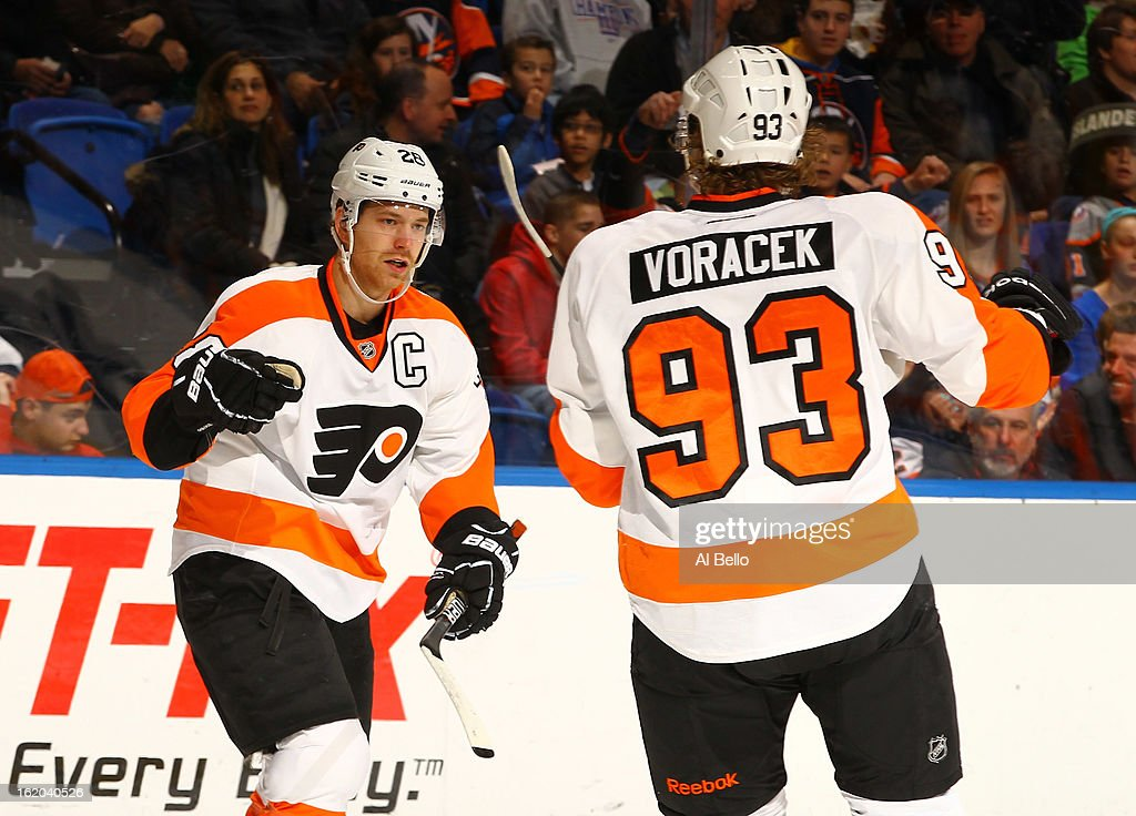 Claude Giroux #28 of the Philadelphia Flyers celebrates his goal with Jakub Voracek #93 against Evgeni Nabokov #20 of the New York Islanders during their game at Nassau Veterans Memorial Coliseum on February 18, 2013 in Uniondale, New York.