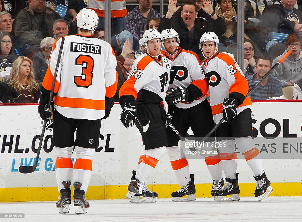 Claude Giroux #28 of the Philadelphia Flyers celebrates his goal with Simon Gagne #12, Matt Read #24 and Kurtis Foster #3 during the second period against the Pittsburgh Penguins on March 24, 2013 at Consol Energy Center in Pittsburgh, Pennsylvania.