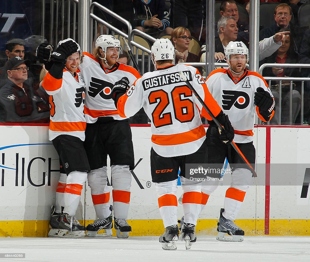 Claude Giroux #28 of the Philadelphia Flyers celebrates his goal with Jakub Voracek #93 and Erik Gustafsson #26 during the third period against the Pittsburgh Penguins on April 12, 2014 at Consol Energy Center in Pittsburgh, Pennsylvania.