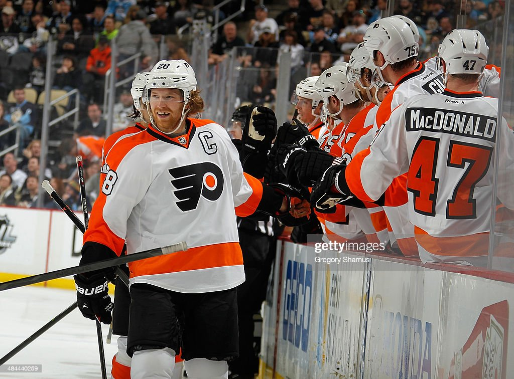 Claude Giroux #28 of the Philadelphia Flyers celebrates his goal with the bench during the third period against the Pittsburgh Penguins on April 12, 2014 at Consol Energy Center in Pittsburgh, Pennsylvania. Philadelphia won the game 4-3 in overtime.
