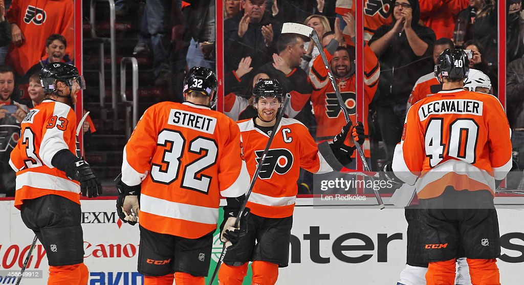 Claude Giroux #28 of the Philadelphia Flyers celebrates his second period power-play goal against the Colorado Avalanche, his second of the game, with teammates Jakub Voracek #93, Mark Streit #32, and Vincent Lecavalier #40 on November 8, 2014 at the Wells Fargo Center in Philadelphia, Pennsylvania.