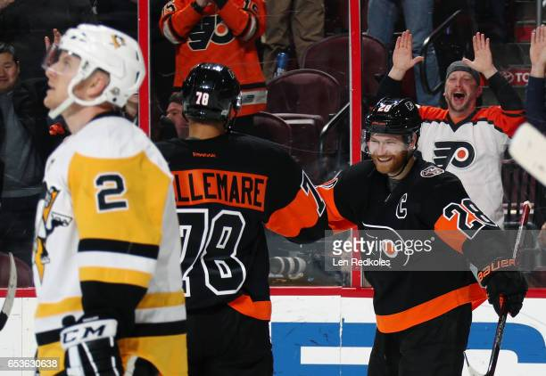 Claude Giroux of the Philadelphia Flyers celebrates his third period goal against the Pittsburgh Penguins with PierreEdouard Bellemare on March 15...