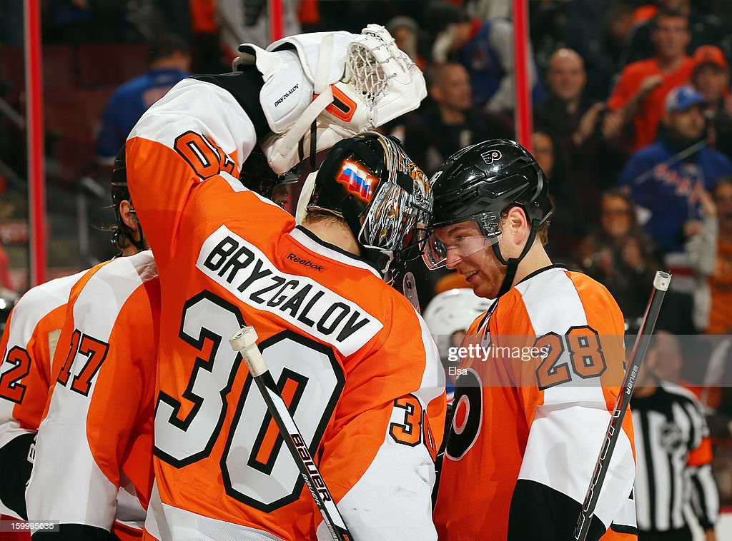<a gi-track='captionPersonalityLinkClicked' href=/galleries/search?phrase=Claude+Giroux&family=editorial&specificpeople=537961 ng-click='$event.stopPropagation()'>Claude Giroux</a> #28 of the Philadelphia Flyers congratulates <a gi-track='captionPersonalityLinkClicked' href=/galleries/search?phrase=Ilya+Bryzgalov&family=editorial&specificpeople=2285430 ng-click='$event.stopPropagation()'>Ilya Bryzgalov</a> #30 on the win after the game against the New York Rangers on January 24, 2013 at the Wells Fargo Center in Philadelphia, Pennsylvania. The Philadelphia Flyers defeated the New York Rangers 2-1.