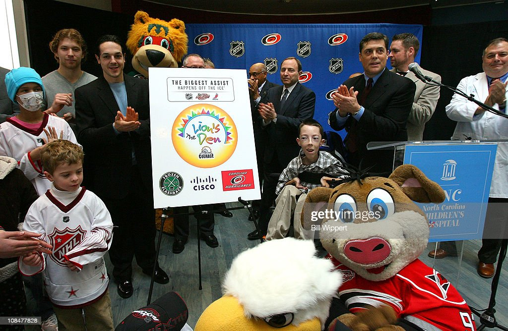 Claude Giroux of the Philadelphia Flyers, Danny Briere of the Philadelphia Flyers, NHL Commissioner Gary Bettman and Pat LaFontaine, President of Companions in Courage unveil the 'Lion's Den' during the Lion's Den 'Champions in Courage' North Carolina Chidren's Hospital Chapel Hill visit as part of 2011 NHL All-Star Weekend on January 28, 2011 in Raleigh, North Carolina.