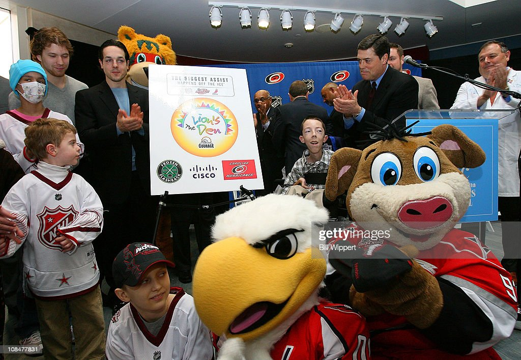 Claude Giroux of the Philadelphia Flyers, Danny Briere of the Philadelphia Flyers and Pat LaFontaine, President of Companions in Courage unveil the 'Lion's Den' during the Lion's Den 'Champions in Courage' North Carolina Chidren's Hospital Chapel Hill visit as part of 2011 NHL All-Star Weekend on January 28, 2011 in Raleigh, North Carolina.