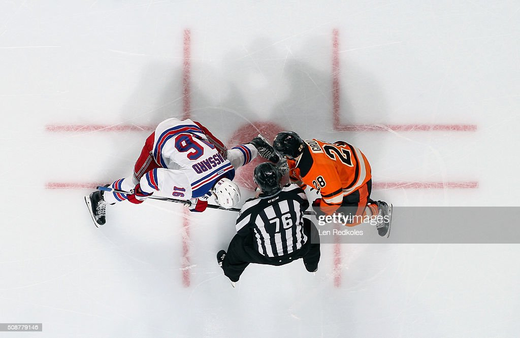 <a gi-track='captionPersonalityLinkClicked' href=/galleries/search?phrase=Claude+Giroux&family=editorial&specificpeople=537961 ng-click='$event.stopPropagation()'>Claude Giroux</a> #28 of the Philadelphia Flyers faces off with <a gi-track='captionPersonalityLinkClicked' href=/galleries/search?phrase=Derick+Brassard&family=editorial&specificpeople=540468 ng-click='$event.stopPropagation()'>Derick Brassard</a> #16 of the New York Rangers on February 6, 2016 at the Wells Fargo Center in Philadelphia, Pennsylvania. The Rangers went on to defeat the Flyers 3-2 in a shootout.