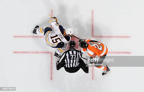Claude Giroux of the Philadelphia Flyers faces off with Jack Eichel of the Buffalo Sabres on October 27 2015 at the Wells Fargo Center in...