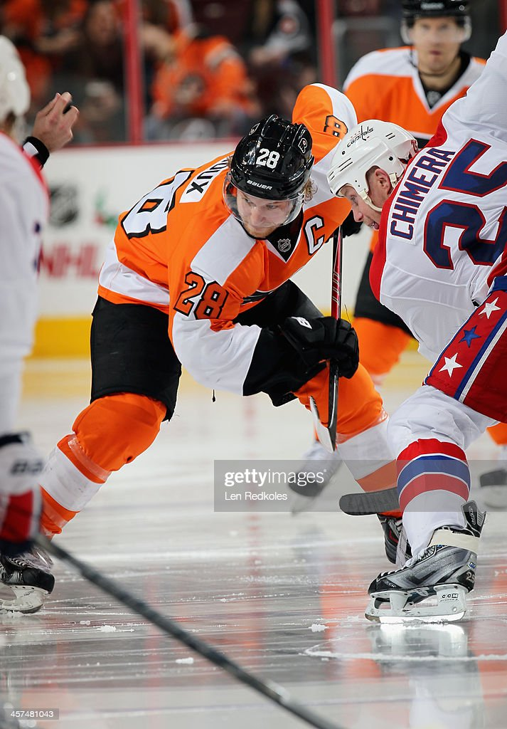 <a gi-track='captionPersonalityLinkClicked' href=/galleries/search?phrase=Claude+Giroux&family=editorial&specificpeople=537961 ng-click='$event.stopPropagation()'>Claude Giroux</a> #28 of the Philadelphia Flyers faces off with <a gi-track='captionPersonalityLinkClicked' href=/galleries/search?phrase=Jason+Chimera&family=editorial&specificpeople=211264 ng-click='$event.stopPropagation()'>Jason Chimera</a> #25 of the Washington Capitals in the third period on December 17, 2013 at the Wells Fargo Center in Philadelphia, Pennsylvania. The Flyers went on to defeat the Capitals 5-2.