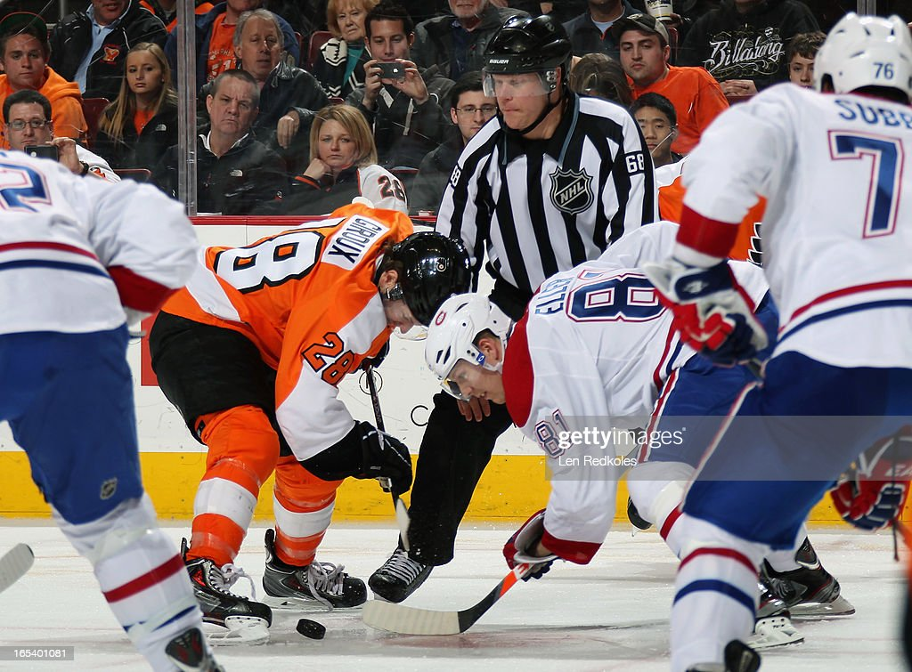 <a gi-track='captionPersonalityLinkClicked' href=/galleries/search?phrase=Claude+Giroux&family=editorial&specificpeople=537961 ng-click='$event.stopPropagation()'>Claude Giroux</a> #28 of the Philadelphia Flyers faces off with <a gi-track='captionPersonalityLinkClicked' href=/galleries/search?phrase=Lars+Eller&family=editorial&specificpeople=4324947 ng-click='$event.stopPropagation()'>Lars Eller</a> #81 of the Montreal Canadiens on April 3, 2013 at the Wells Fargo Center in Philadelphia, Pennsylvania. The Flyers went on to defeat the Canadiens 5-3.