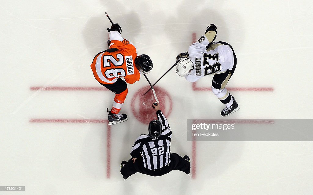 Claude Giroux #28 of the Philadelphia Flyers faces off with Sidney Crosby #87 of the Pittsburgh Penguins on March 15, 2014 at the Wells Fargo Center in Philadelphia, Pennsylvania. The Flyers went on to defeat the Penguins 4-0.