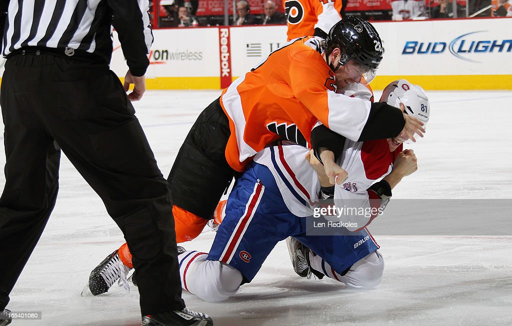 <a gi-track='captionPersonalityLinkClicked' href=/galleries/search?phrase=Claude+Giroux&family=editorial&specificpeople=537961 ng-click='$event.stopPropagation()'>Claude Giroux</a> #28 of the Philadelphia Flyers fights <a gi-track='captionPersonalityLinkClicked' href=/galleries/search?phrase=Lars+Eller&family=editorial&specificpeople=4324947 ng-click='$event.stopPropagation()'>Lars Eller</a> #81 of the Montreal Canadiens in the third period on April 3, 2013 at the Wells Fargo Center in Philadelphia, Pennsylvania. The Flyers went on to defeat the Canadiens 5-3.