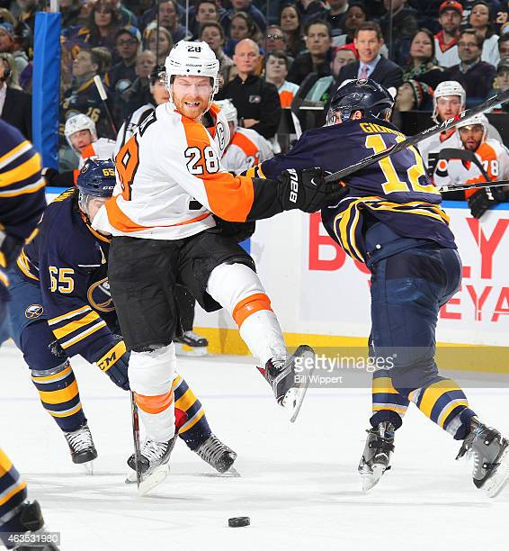 Claude Giroux of the Philadelphia Flyers gets checked by Brian Gionta of the Buffalo Sabres on February 15 2015 at the First Niagara Center in...
