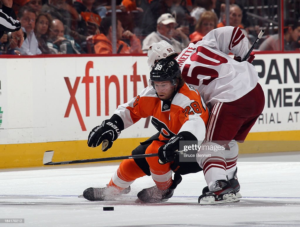 <a gi-track='captionPersonalityLinkClicked' href=/galleries/search?phrase=Claude+Giroux&family=editorial&specificpeople=537961 ng-click='$event.stopPropagation()'>Claude Giroux</a> #28 of the Philadelphia Flyers is checked by <a gi-track='captionPersonalityLinkClicked' href=/galleries/search?phrase=Antoine+Vermette&family=editorial&specificpeople=206302 ng-click='$event.stopPropagation()'>Antoine Vermette</a> #50 of the Phoenix Coyotes at the Wells Fargo Center on October 11, 2013 in Philadelphia, Pennsylvania. The Coyotes defeated the Flyers 2-1.