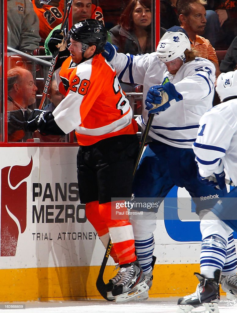 <a gi-track='captionPersonalityLinkClicked' href=/galleries/search?phrase=Claude+Giroux&family=editorial&specificpeople=537961 ng-click='$event.stopPropagation()'>Claude Giroux</a> #28 of the Philadelphia Flyers is checked by Mike Kostka #53 of the Toronto Maple Leafs in the third period of an NHL Hockey game at Wells Fargo Center on February 25, 2013 in Philadelphia, Pennsylvania.