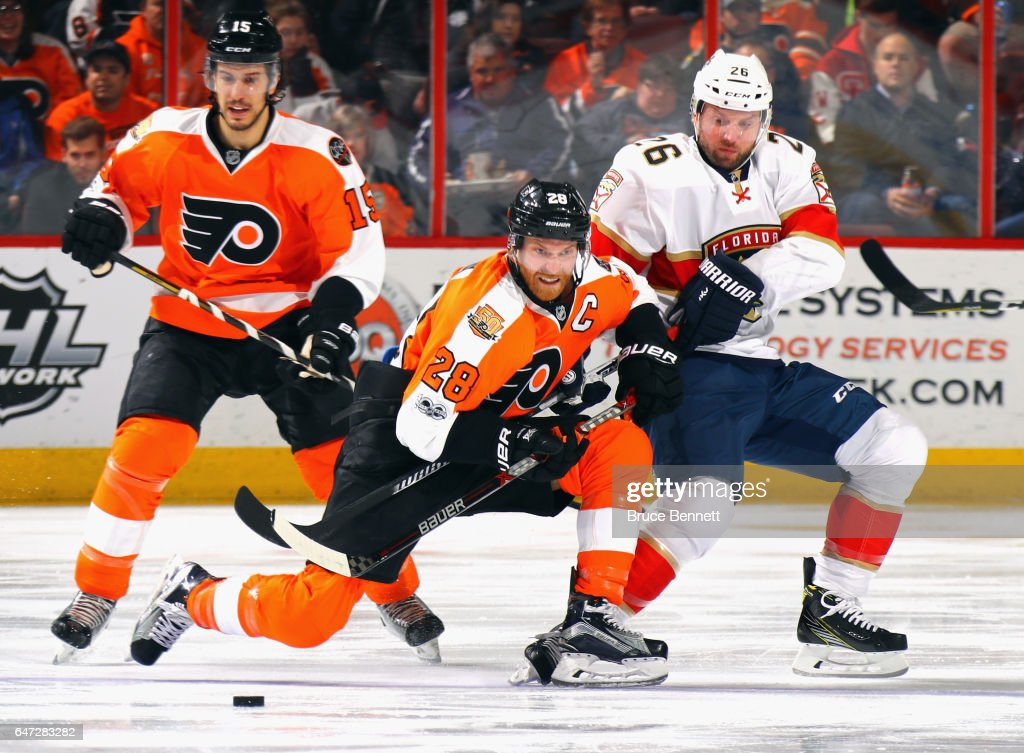 Claude Giroux #28 of the Philadelphia Flyers is checked by Thomas Vanek #26 of the Florida Panthers during the second period at the Wells Fargo Center on March 2, 2017 in Philadelphia, Pennsylvania.